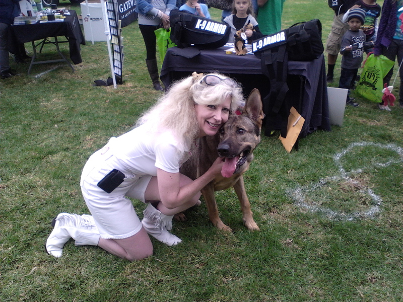 Anaheim PD K9 Guenther giving hugs to Suzanne Saunders, Co-Founder K-9 Armor