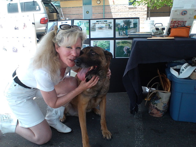 Dos Palos PD K9 Scar pauses for hugs from Suzanne Saunders, K-9 Armor Co-Founder.