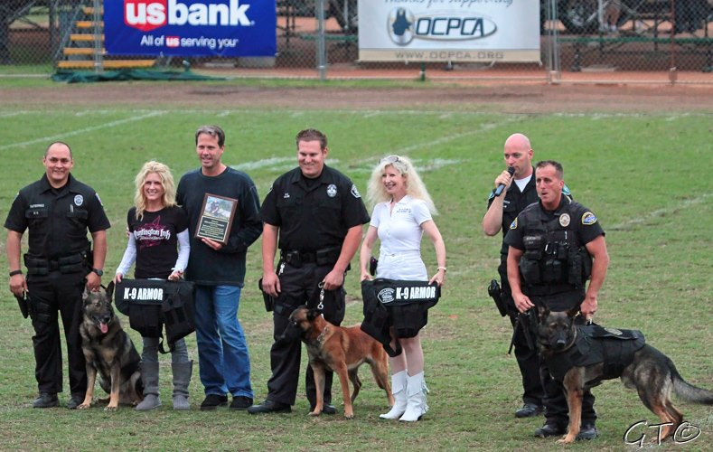 Orange PD Officer Gutierrez with K9 Lycan, Krista and Mike Pennington who generously donated for six vests, Fullerton PD Officer Miller with K9 Mueller, K-9 Armor Co-Founder Suzanne Saunders, OCPCA Pres. Bob Smith and Huntington Beach PD Officer Ricci with K9 Xavi.