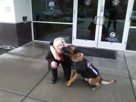 Suzanne Saunders of K-9 Armor receives K9 kisses from Richmond PD K9 Bosco
