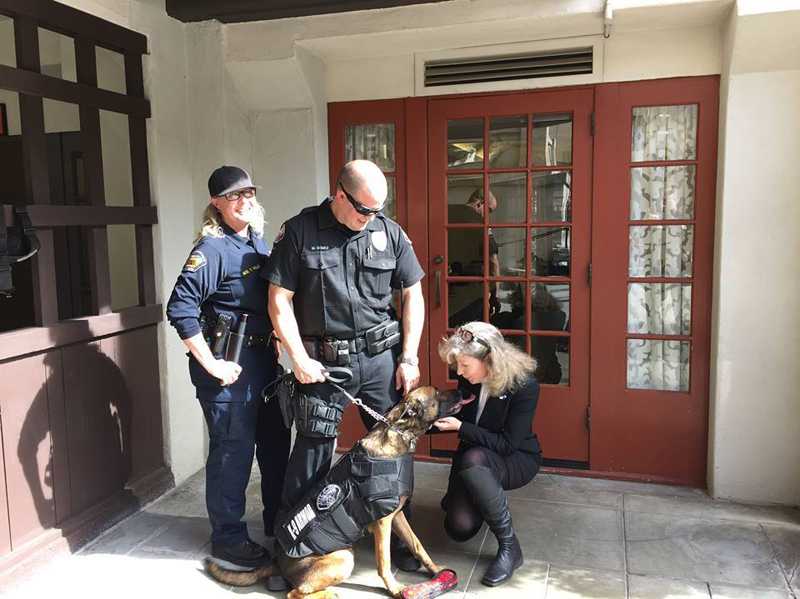 Riverside County Animal Control Officer Tiffany FullerHemet with PD Officer Matt Gomez and K9 Jack giving kisses to K9 Armor Cofounder Suzanne Saunders