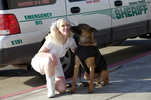 Sonoma County Sheriff K9 Axl giving kisses to Suzanne Saunders, K-9 Armor for his free bulletproof vest